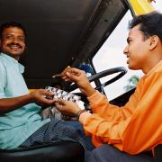 A practitioner talking to a truck drive in Bangladesh