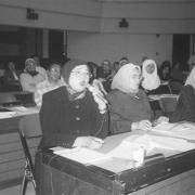 Women participating in a meeting