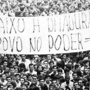 Banner held by protesters in Brazil