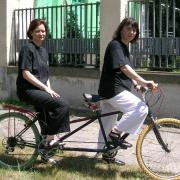 Two women on a bicycle for two