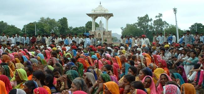 Women gather for a public meeting